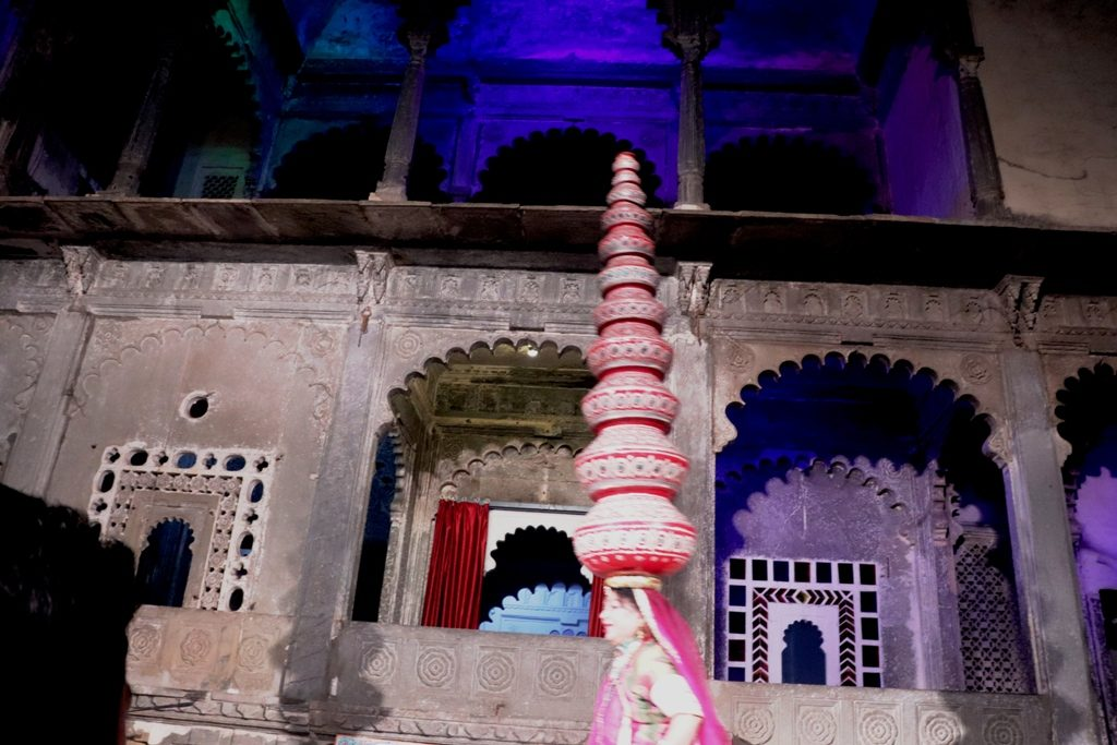 Dancer balancing 11 earthen pots in Bhawai Dance